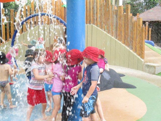 Children playing in a sun safe water park